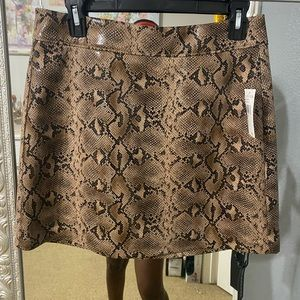 NWT tan snakeskin skirt.